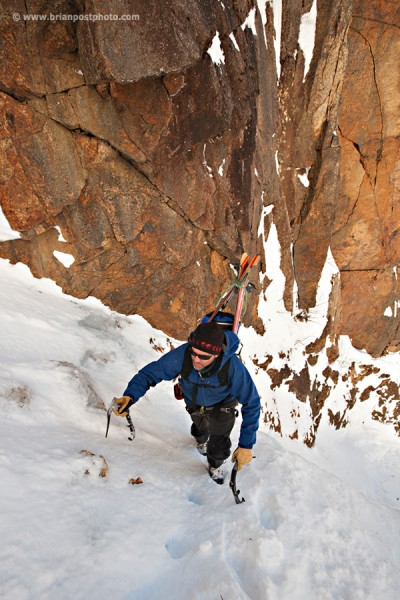 Jim Surette climbing the lower part of Shoestring Gully on Mount Webster for a ski descent. A complete descent without rappel was made thanks to recent storms that loaded the gully with deep snow.
