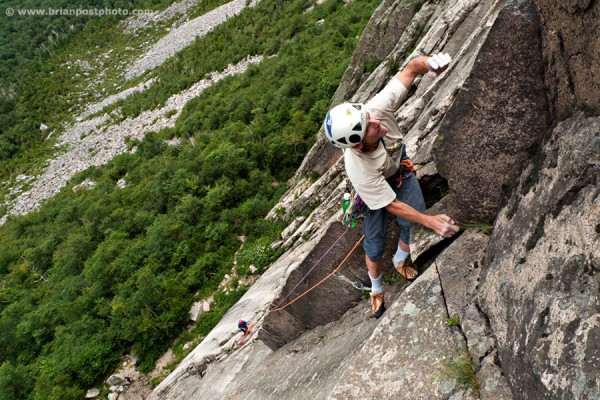 Andy Tuthill leading the 2nd pitch (5.10+) of the VMC Direct Direct on Cannon Cliff in Franconia Notch, New Hampshire.